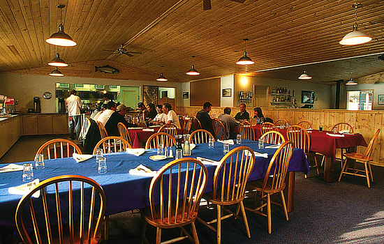 Visitors to the Knight Inlet Lodge in Campbell River sit in the dining room and chat with other guests