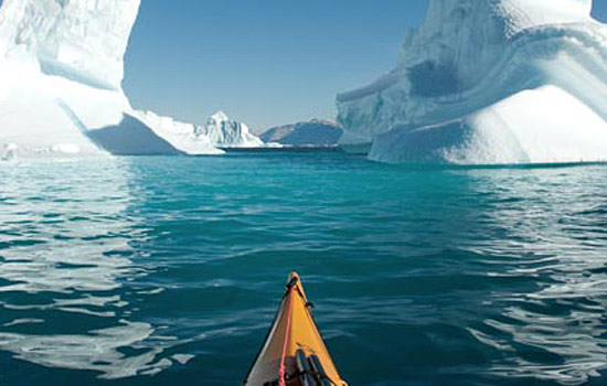 Paddle a sea kayak between giant icebergs