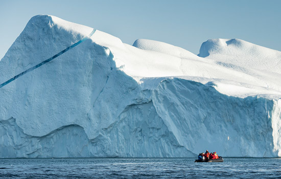 Adventurers explore arctic glaciers by zodiac